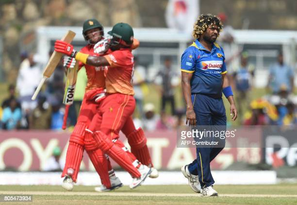 Zimbabwe cricketer Hamilton Masakadza and Craig Ervine run between the wickets as Sri Lankan cricketer Lasith Maling looks on during the second...