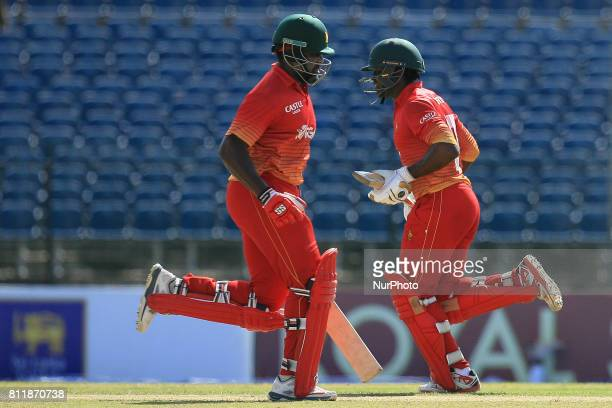 Zimbabwe cricketer Hamilton Masakadza and Solomon Mire run between the wickets during the 5th One Day International cricket match between Sri Lanka...