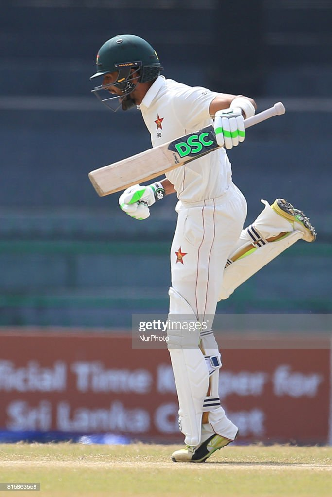 Zimbabwe cricketer Sikandar Raza in celebration mood after scoring 100 runs during the 4th day's play in the only Test match between Sri Lanka and Zimbabwe at R Premadasa International Cricket Stadium in the capital city of Colombo, Sri Lanka on Monday 17th July 2017