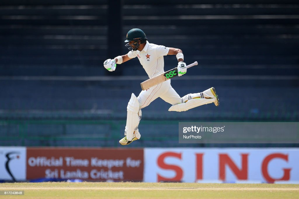 Zimbabwe cricketer Sikandar Raza leaps in the air in celebration after scoring 100 runs during the 4th day's play in the only Test match between Sri Lanka and Zimbabwe at R Premadasa International Cricket Stadium in the capital city of Colombo, Sri Lanka on Monday 17th July 2017