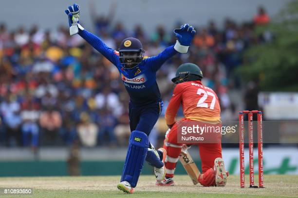 Zimbabwe cricketer Solomon Mire is dismissed as Sri Lanka's wicket keeper Niroshan Dickwella celebrates during the 4th One Day International cricket...