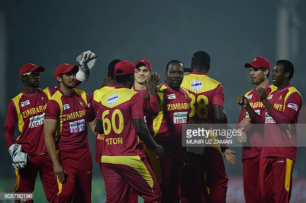 Zimbabwe cricketers celebrate after the dismissal of the Bangladesh cricketer Sabbir Rahman during the third T20 cricket match between Bangladesh and...