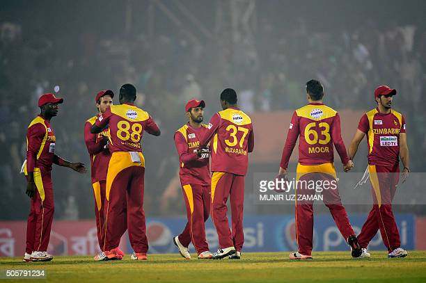 Zimbabwe cricketers celebrate after winning the third T20 cricket match between Bangladesh and Zimbabwe at the Sheikh Abu Naser Stadium in Khulna on...