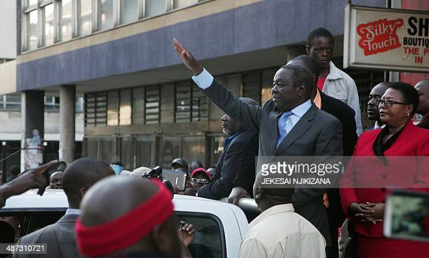 Zimbabwe main opposition party Movement for Democratic Change President Morgan Tsvangirai waves at supporters as they celebrate his decision to oust...
