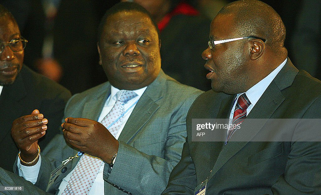 Zimbabwe MDC president <a gi-track='captionPersonalityLinkClicked' href=/galleries/search?phrase=Morgan+Tsvangirai&family=editorial&specificpeople=800701 ng-click='$event.stopPropagation()'>Morgan Tsvangirai</a> (L) and Zimbabwean MDC Secretary general <a gi-track='captionPersonalityLinkClicked' href=/galleries/search?phrase=Tendai+Biti&family=editorial&specificpeople=2570965 ng-click='$event.stopPropagation()'>Tendai Biti</a> attend on August 16, 2008 the Southern African Development Community (SADC) summit in Johannesburg. The summit of southern African leaders opened with Zimbabwe's political rivals in attendance as negotiators aimed to reach a deal to end the country's political crisis. Zimbabwe's President Robert Mugabe entered the summit with the heads of other southern African nations, while his arch-rival, opposition leader <a gi-track='captionPersonalityLinkClicked' href=/galleries/search?phrase=Morgan+Tsvangirai&family=editorial&specificpeople=800701 ng-click='$event.stopPropagation()'>Morgan Tsvangirai</a>, took a seat in the front row of invited guests.