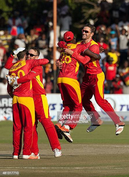 Zimbabwe player Craig Ervine jumps in an embrace with Christopher Mpofu as they celebrate a victory during the second and final game in a series of...