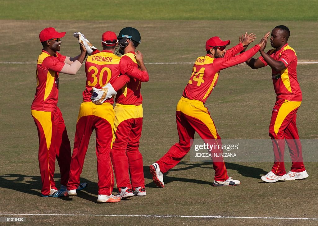 Zimbabwe players celebrate a wicket during the second and final game in a series of two Twenty20 international cricket matches between Zimbabwe and...