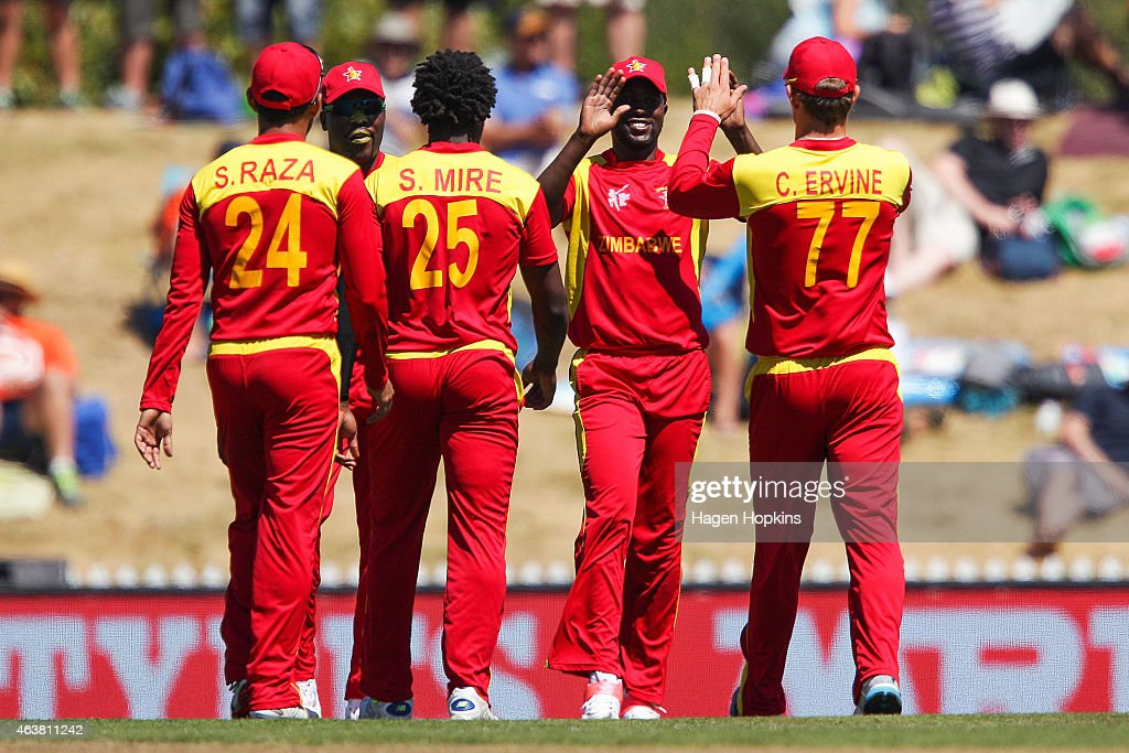 Zimbabwe players celebrate the wicket of Krishna Karate of the United Arab Emirates during the 2015 ICC Cricket World Cup match between Zimbabwe and...