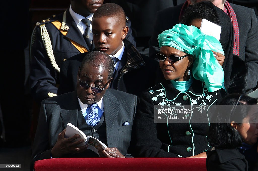 Zimbabwe President <a gi-track='captionPersonalityLinkClicked' href=/galleries/search?phrase=Robert+Mugabe&family=editorial&specificpeople=214676 ng-click='$event.stopPropagation()'>Robert Mugabe</a> and his wife Grace attend the Inauguration Mass for Pope Francis in St Peter's Square on March 19, 2013 in Vatican City, Vatican. The mass is being held in front of an expected crowd of up to one million pilgrims and faithful who have filled the square and the surrounding streets to see the former Cardinal of Buenos Aires officially take up his role as pontiff. Pope Francis' inauguration takes place in front of Cardinals and spiritual leaders as well as heads of state from around the world.