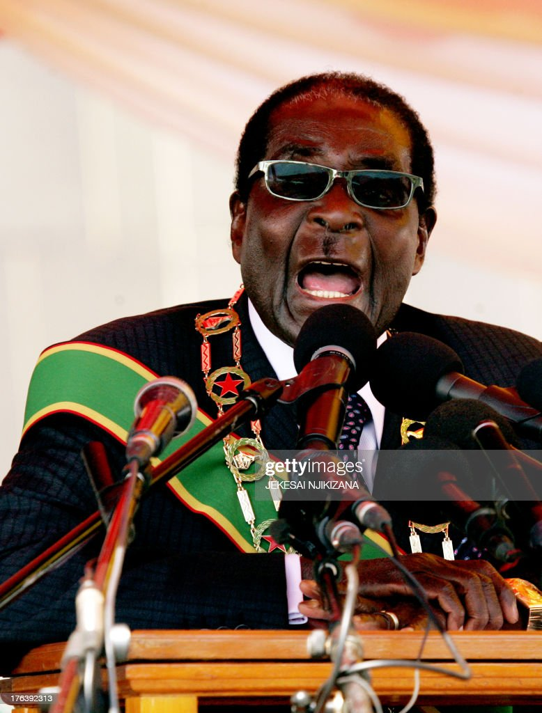 Zimbabwe President <a gi-track='captionPersonalityLinkClicked' href=/galleries/search?phrase=Robert+Mugabe&family=editorial&specificpeople=214676 ng-click='$event.stopPropagation()'>Robert Mugabe</a> delivers a speech at the National Heroes Acre in Harare on August 12, 2013 during Heroes Day celebrations. Mugabe told those upset by his disputed landslide election win to 'go hang,' vowing his victory would never be overturned. Mugabe was declared the winner with 61 percent of the ballots, against Tsvangirai's 34 percent. Tsvangirai meanwhile vowed to expose 'glaring evidence of the stolen vote' through a court bid.