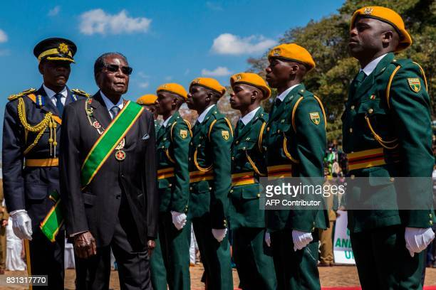 TOPSHOT Zimbabwe President Robert Mugabe inspects a guard of honour during official Heroes Day commemorations held at National Heroes Acre in...