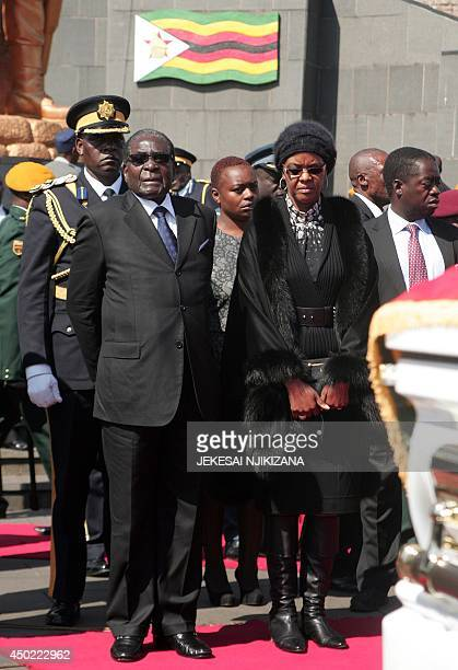 Zimbabwe President Robert Mugabe with the first lady Grace Mugabe attend the funeral of a stalwart of the ruling ZANUPF party at the National Heroes...