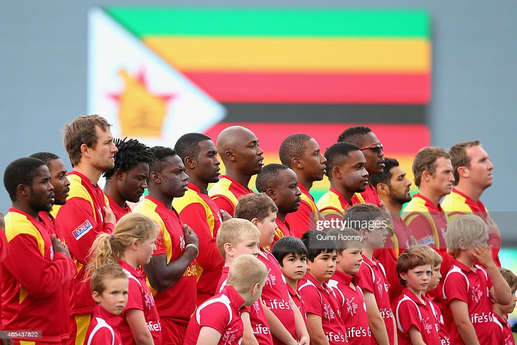 Zimbabwe stand for the national anthem during the 2015 ICC Cricket World Cup match between Zimbabwe and Ireland at Bellerive Oval on March 7 2015 in...
