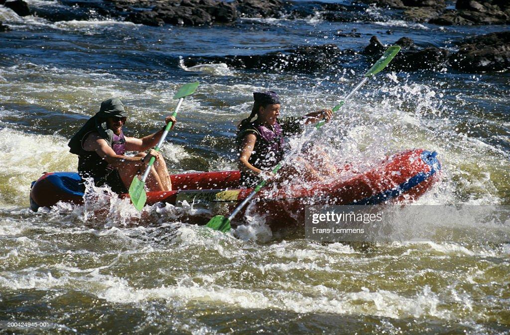 Zimbabwe, Zambezi River, tourists kayaking in river