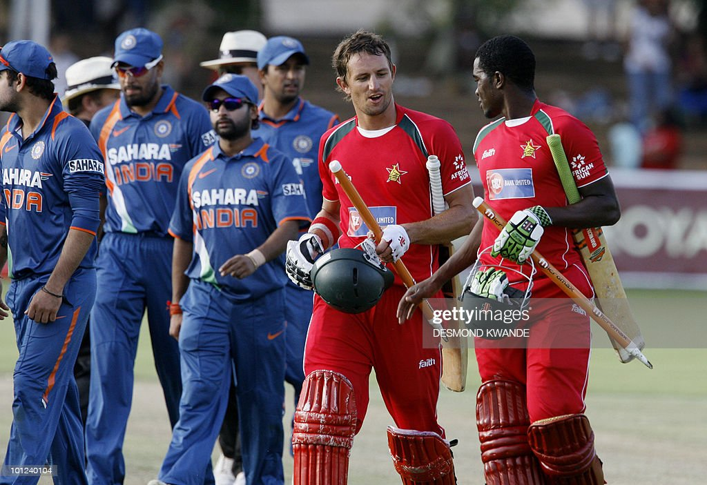 Zimbabwean captain Elton Chigumbura (R) with his team mate Craig Ervine walks off the field, after winning the match againt India by six wickets, in the first match of the Micromax Cup Triangular One-Day International series on May 28, 2010 at Queens Sports club in Bulawayo. AFP PHOTO / Desmond Kwande
