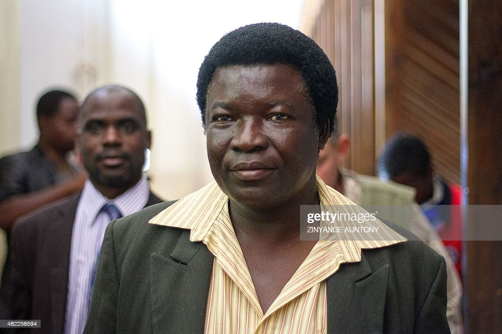 Zimbabwean local landowner Honest Ndlovu arrives at the Prosecutor's office at the Magistrate's Court in Hwange on July 29 for a hearing in...