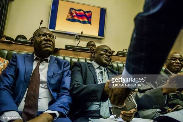 TOPSHOT Zimbabwean Members of Parliament sit in the house of assembly during a parliamentary session where a motion is moved to impeach President...