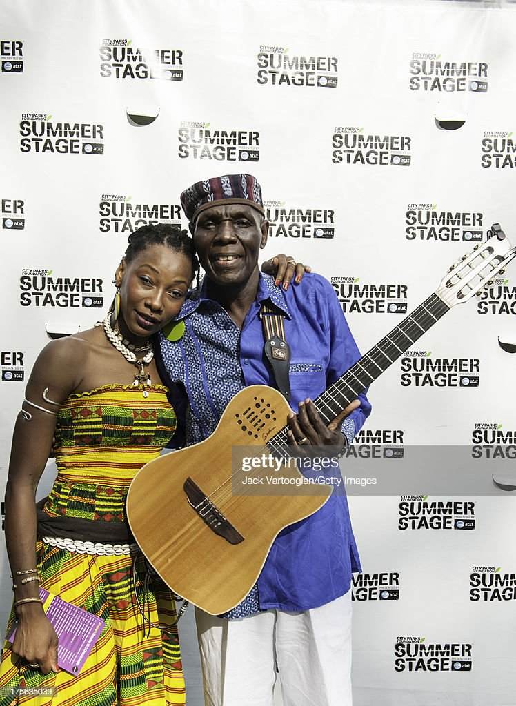 Zimbabwean musician Oliver Mtukudzi (right) poses backstage with Malian singer <a gi-track='captionPersonalityLinkClicked' href=/galleries/search?phrase=Fatoumata+Diawara&family=editorial&specificpeople=6928565 ng-click='$event.stopPropagation()'>Fatoumata Diawara</a> prior to his headline set at Central Park SummerStage, New York, New York, July 21, 2013.