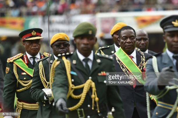 Zimbabwean new interim President Emmerson Mnangagwa performs his first inspection of the Guard of Honour accompanied by military chiefs after he is...