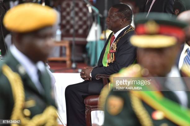 Zimbabwean new interim President Emmerson Mnangagwa sits after he was officially swornin during a ceremony in Harare on November 24 2017 Emmerson...