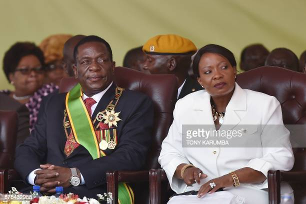 Zimbabwean new interim President Emmerson Mnangagwa sits with his wife Firstlady Auxillia after he was officially swornin during a ceremony in Harare...