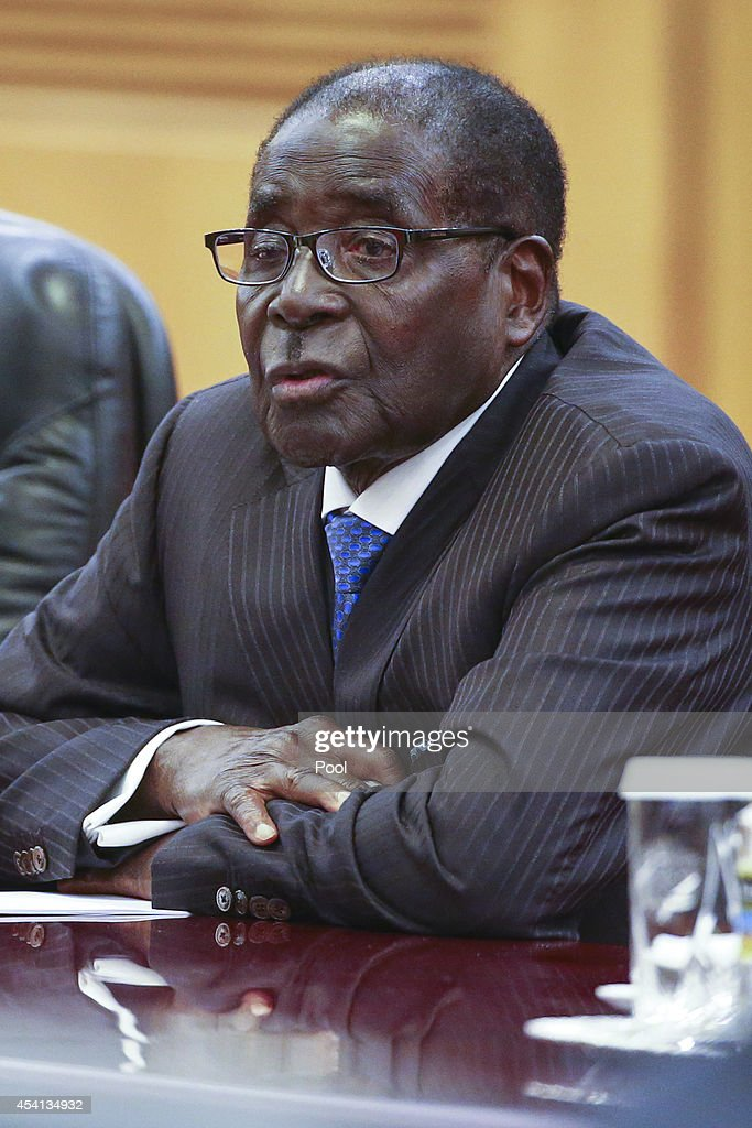 Zimbabwean President <a gi-track='captionPersonalityLinkClicked' href=/galleries/search?phrase=Robert+Mugabe&family=editorial&specificpeople=214676 ng-click='$event.stopPropagation()'>Robert Mugabe</a> attends a bilateral meeting with his Chinese counterpart Xi Jinping (not pictured) at the Great Hall of the People (GHOP) on August 25, 2014 in Beijing, China. Mugabe is on a five-day state visit to China.
