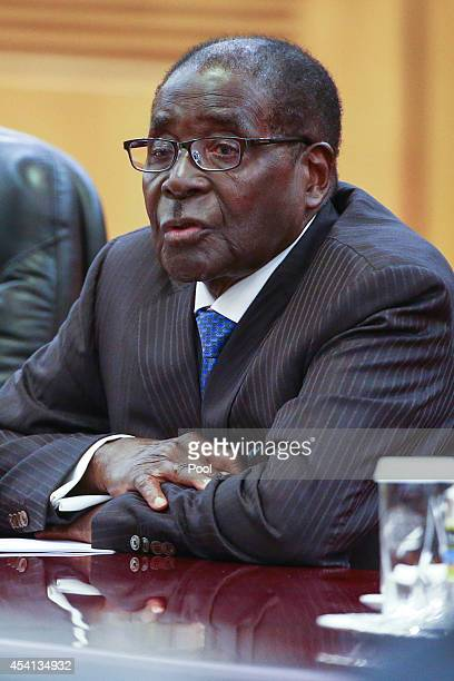 Zimbabwean President Robert Mugabe attends a bilateral meeting with his Chinese counterpart Xi Jinping at the Great Hall of the People on August 25...