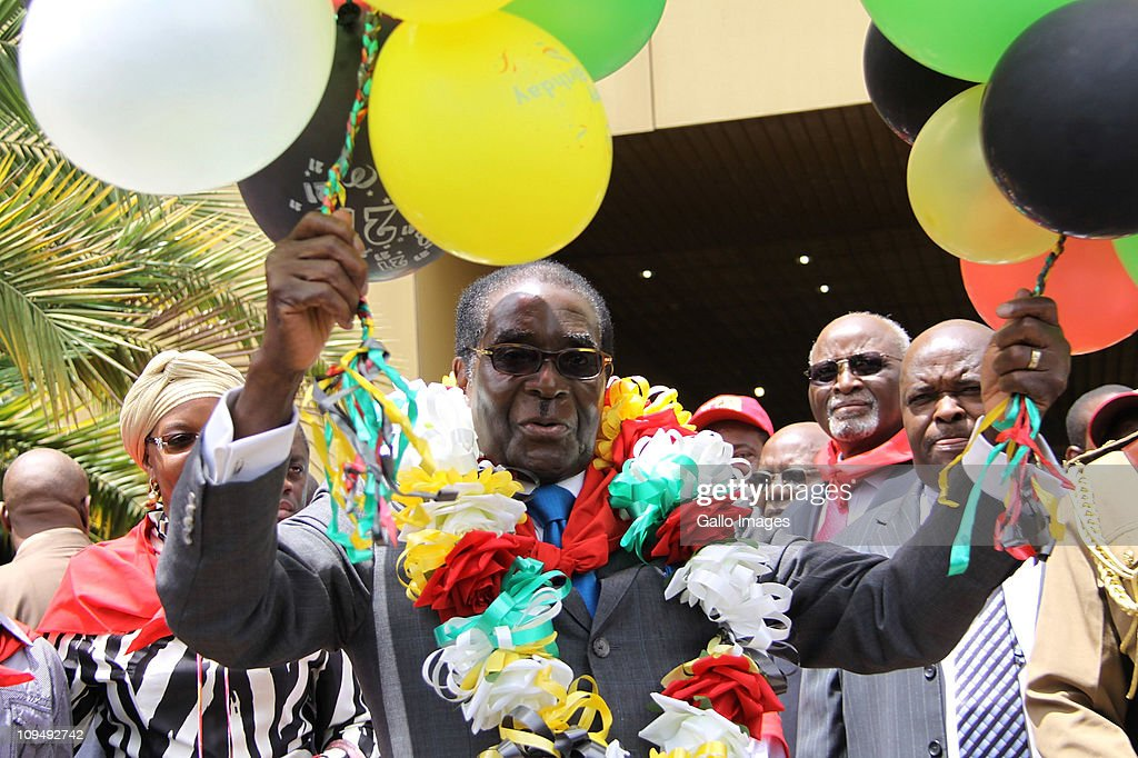 Zimbabwean President <a gi-track='captionPersonalityLinkClicked' href=/galleries/search?phrase=Robert+Mugabe&family=editorial&specificpeople=214676 ng-click='$event.stopPropagation()'>Robert Mugabe</a> celebrates his 87th birthday at the Harare International Conference Centre on February 26, 2011 in Harare, Zimbabwe.