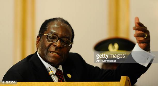 Zimbabwean president Robert Mugabe delivers a speech during the closing ceremony of the 30th Southern African Development Community summit on August...