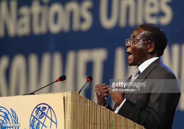 Zimbabwean President Robert Mugabe gives a speech 02 September 2002 at Sandton convention center in Johannesburg Leaders from around the world were...