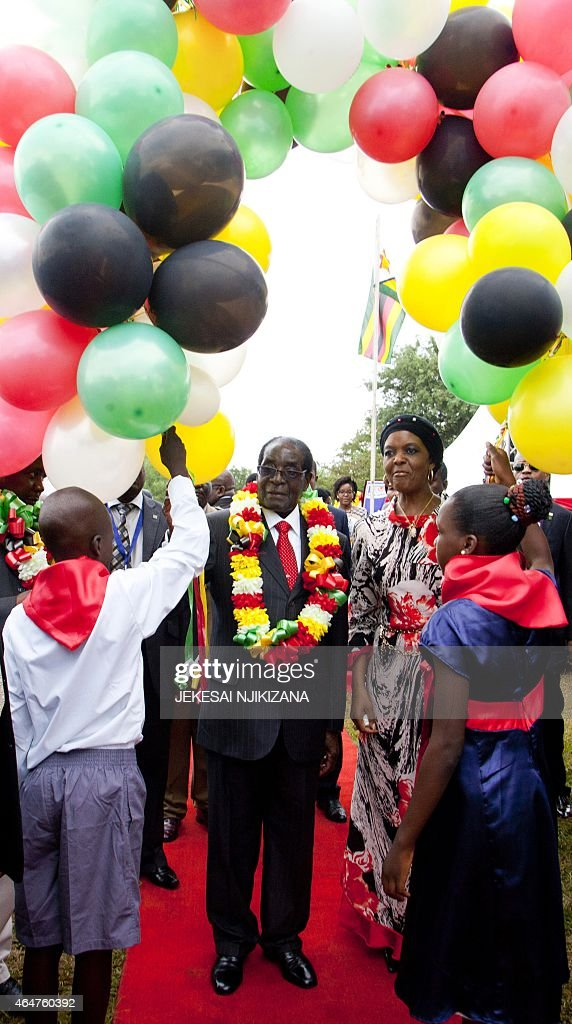 Zimbabwean President <a gi-track='captionPersonalityLinkClicked' href=/galleries/search?phrase=Robert+Mugabe&family=editorial&specificpeople=214676 ng-click='$event.stopPropagation()'>Robert Mugabe</a> (C) is ready to release 91 baloons next to lady <a gi-track='captionPersonalityLinkClicked' href=/galleries/search?phrase=Grace+Mugabe&family=editorial&specificpeople=2893817 ng-click='$event.stopPropagation()'>Grace Mugabe</a> (R) during celebration, on February 28, 2015, of Mugabe's 91st birthday in Victoria Falls. Mugabe celebrated his 91st birthday with a lavish million dollar bash that was slammed by the opposition as 'obscene' in a country wracked by poverty.The extravagance of Mugabe's birthday parties are a subject of annual controversy in Zimbabwe.