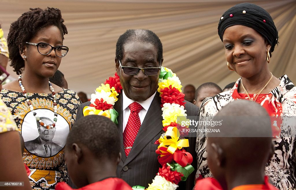 Zimbabwean President <a gi-track='captionPersonalityLinkClicked' href=/galleries/search?phrase=Robert+Mugabe&family=editorial&specificpeople=214676 ng-click='$event.stopPropagation()'>Robert Mugabe</a> (C), lady <a gi-track='captionPersonalityLinkClicked' href=/galleries/search?phrase=Grace+Mugabe&family=editorial&specificpeople=2893817 ng-click='$event.stopPropagation()'>Grace Mugabe</a> (R) and his daughter Bona (L) attend on February 28, 2015 the celebration of Mugabe's 91st birthday in Victoria Falls. Mugabe celebrated his 91st birthday with a lavish million dollar bash that was slammed by the opposition as 'obscene' in a country wracked by poverty.The extravagance of Mugabe's birthday parties are a subject of annual controversy in Zimbabwe.
