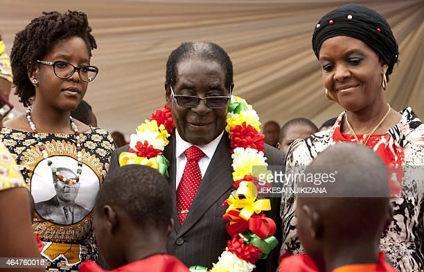 Zimbabwean President Robert Mugabe lady Grace Mugabe and his daughter Bona attend on February 28 2015 the celebration of Mugabe's 91st birthday in...