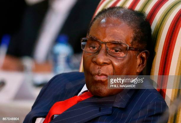 Zimbabwean President Robert Mugabe looks on as he attends the 2nd Session of the South AfricaZimbabwe binational Commission on October 3 2017 at...