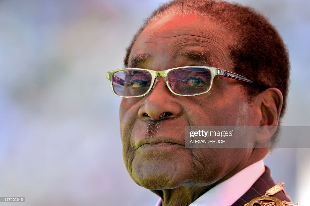 Zimbabwean President <a gi-track='captionPersonalityLinkClicked' href=/galleries/search?phrase=Robert+Mugabe&family=editorial&specificpeople=214676 ng-click='$event.stopPropagation()'>Robert Mugabe</a> looks on during his inauguration and swearing-in ceremony on August 22, 2013 at the 60,000-seater sports stadium in Harare. Veteran Zimbabwean President <a gi-track='captionPersonalityLinkClicked' href=/galleries/search?phrase=Robert+Mugabe&family=editorial&specificpeople=214676 ng-click='$event.stopPropagation()'>Robert Mugabe</a> was sworn in as Zimbabwe's president for another five-year term before a stadium packed with tens of thousands of jubilant supporters.