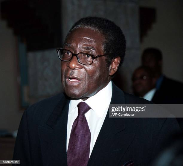 Zimbabwean President Robert Mugabe speaks 11 October 2000 during the Southern Africa trade and investment summit in Windhoek Mugabe urged...