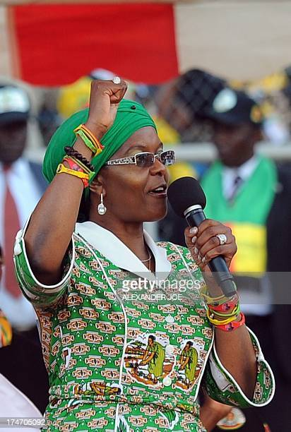 Zimbabwean President's wife Grace Mugabe raises her fist as she addresses at a rally in Harare on July 28 2013 Zimbabweans go to the polls on July 31...