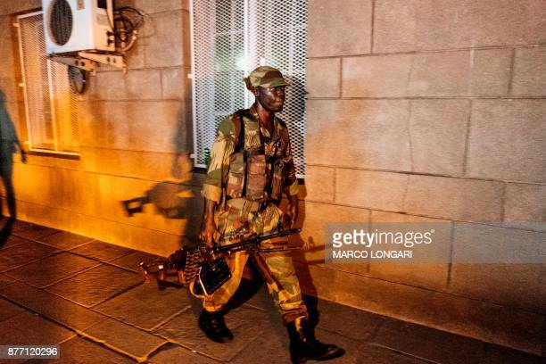 A Zimbabwean soldier walks in the street of Harare as the population celebrates after the resignation of President Mugabe on November 21 2017 Robert...