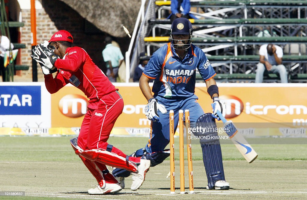 Zimbabwean wicket keeper Tatenda Taibu runs out Indian batsman Murali Vijay (R) at Harare Sports Club on June 3, 2010 in the fourth match of the Micromax Cup Triangular One-Day series which includes Sri Lanka. AFP PHOTO / Desmond Kwande