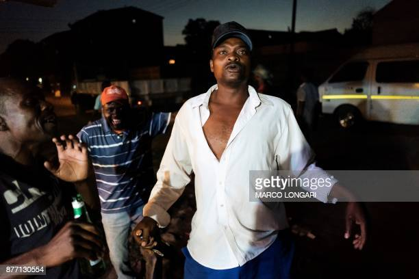 Zimbabweans celebrate in the street of Harare after the resignation of Zimbabwe's president Robert Mugabe on November 21 2017 in Harare The bombshell...
