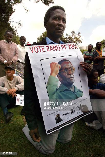 Zimbabweans living in South Africa take part 06 March 2002 in an election rally in support of President Robert Mugabe in his ruling ZANUPF party in...