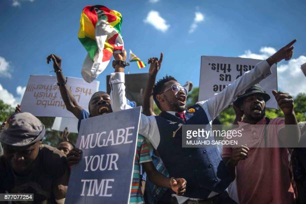 TOPSHOT Zimbabweans shouts as they gather at Unity square opposite to the Parliament to protest against Zimbabwean President Robert Mugabe on...