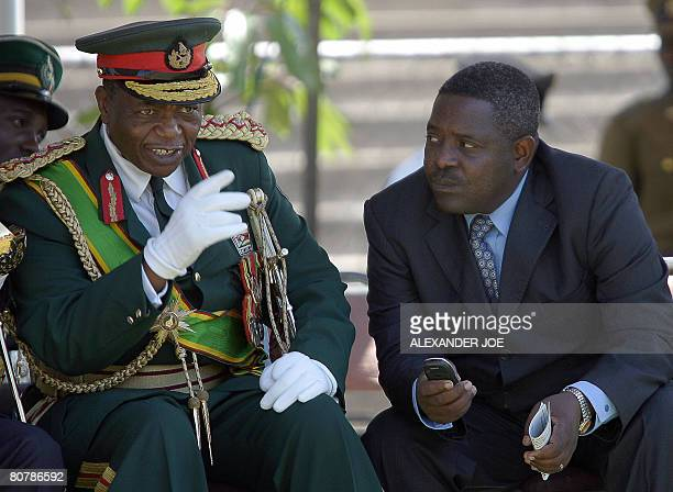 Zimbabwe's Army Commander General Constantine Chiwenga chats with the head of Zimbabwe's Director General of the Central Intelingence Organisation...