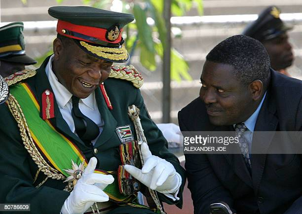 Zimbabwe's Army Commander General Constantine Chiwenga chats with the head of Zimbabwe's Director General of the Central Intellingence Organisation...