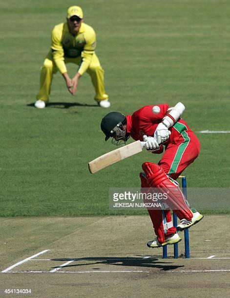 Zimbabwe's batsman Sikandar Raza Butt ducks a bowl during the one day international triseries opening cricket match Zimbabwe vs Australia at the...