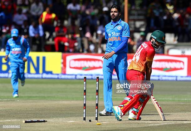 Zimbabwe's batsman Sikandar Raza Butt loses his wicket to India's bowler Barinder Sran during the first oneday international matches between India...