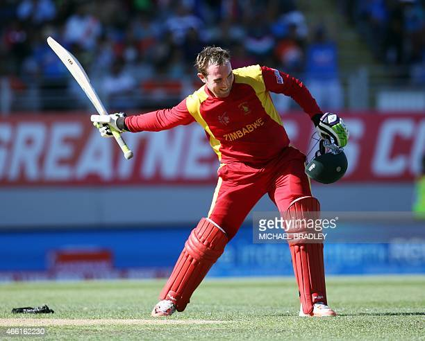 Zimbabwe's Brendan Taylor celebrates his 100 runs during the Pool B Cricket World Cup match between India and Zimbabwe at Eden Park in Auckland on...