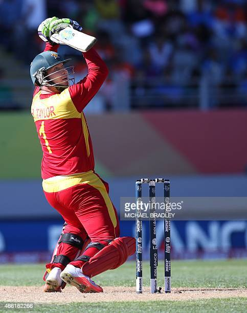 Zimbabwe's Brendan Taylor hits a 6 to bring up his 100 runs during the Pool B Cricket World Cup match between India and Zimbabwe at Eden Park in...