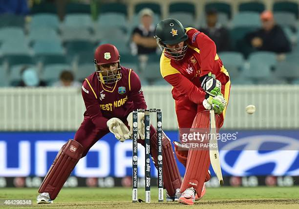 Zimbabwe's Brendan Taylor plays a shot past West Indies wicketkeeper Denesh Ramdin during the 2015 Cricket World Cup Pool B match between the West...