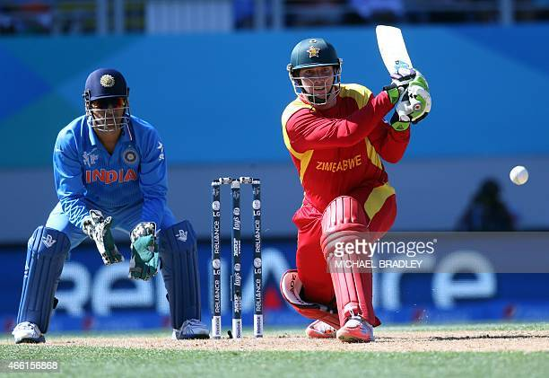 Zimbabwe's Brendan Taylor plays a shot watched on by India's captain Mahendra Singh Dhoni during the Pool B Cricket World Cup match between India and...